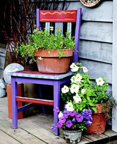 Paint an old chair and use as a plant stand.