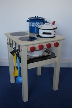 turn a plain stool/table into a play kitchen - this is a great idea for our church nursery/kid's room!