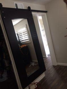 Sliding mirror door to the bathroom