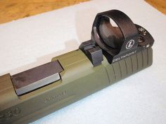 Mark Housel http://www.landmprecisiongunworks.com has figured out a way to mill a P30 slide to where it will accept a mini red dot sight, retain all the safeties and have co-witnessed suppressor height iron sights.