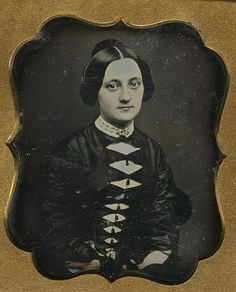 Hand-tinted daguerreotype portrait of a woman, ca. 1845-1849.
