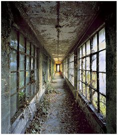 Stephen Wilkes photographed a side of Ellis Island that no one sees. Ellis Island: Ghosts of Freedom documents weather-beaten remnants of the immigration hub's abandoned buildings. Abandoned Buildings, Abandoned Asylums, Old Buildings, Abandoned Places, Derelict Places, Abandoned Castles, Abandoned Plantations, Haunted Places, Ellis Island
