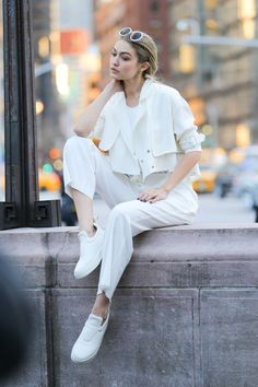 We love Gigi Hadid's *epic* street style! She is always giving us amazing fashion inspiration.  This outfit would be perfect for the spring or summer!  On a shoot in NYC, Hadid donned a crisp, all-white ensemble punctuated with a pair of white geriatric sneakers we weirdly kind of want now?