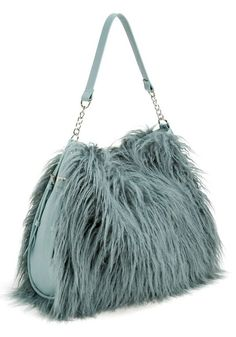 Explore luxury faux fur coats, jackets, clothing and accessories for women, men and kids plus throws, pillows and rugs at Donna Salyers Fabulous Furs. Lamb Bags, Fabulous Furs, Duck Egg Blue, Basket Bag, Hobo Bag, Teal Blue, Purses And Bags, Faux Fur, Fashion Accessories
