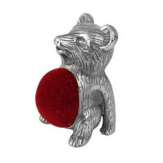 Pewter teddy bear pin cushion. I have one like this only the velvet is blue. Photo via ebay.....