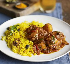 Spice up chicken thighs in a South African curry, packed with flavourful spices and served with a side of sweet, fragrant rice