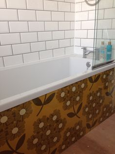 My bathroom remodel with homemade Orla Kiely wallpaper bath panel