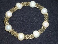 VTG 11MM WHITE BAROQUE PEARL AND VINTAGE FINDING STRETCH BRACELET-NEW OLD STOCK #Unbranded