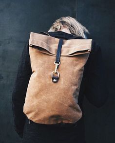Gorgeous waxed canvas with brass hardware. Waterproof. Available online.