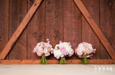 Wedding photo idea: lush pink bouquets lined up against the barn wall. Navy and Pink Barn Wedding at The Reid Barn in Georgia | Audrey Grace Photography