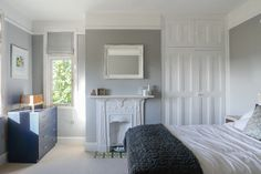 Glorious grey spare room by Things We Make. Grey is Chic Shadow, Dulux, with crisp white gloss.