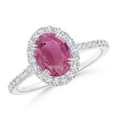 Double Claw Oval Pink Tourmaline Halo Ring with Diamond Accents. Just the perfect birthday gift for the october born. #octoberbirthstone