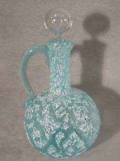 Victorian art glass craquelle ewer. Pale blue glass with a white spatter ...