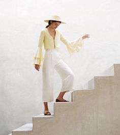 Everything - I mean, everything - from Staud's latest collection has me fantasizing about traveling to a remote Mediterranean island, doing nothing but going to the beach, shopping at local markets while wearing cotton seersucker dresses, tie front button ups, and ruffled satin crepe camisoles. And