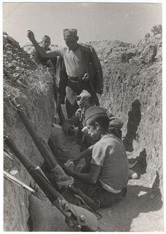 Republican soldiers in a trench, Battle of Brunete, Spain, June 1937//Gerda Taro