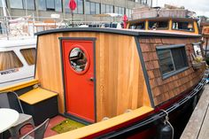 This vessel makes adorable use of 400 square feet, with a unique layout featuring large, round portals. Houseboat Rentals, Row Row Row, Water House, Floating House, West Lake, Square Feet, Seattle, Home And Family, Shed