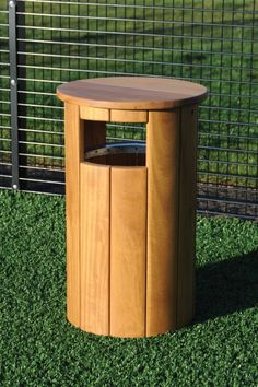 Winchester Canopied Timber Litter Bin - Street Furniture Our latest wooden litter bin range can be supplied in both canopied and open top variants, is functional and stylish. The wood finish will compliment any park or open space environment.