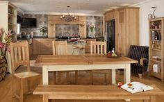 Bespoke kitchen in solid oak with solid oak extending kitchen table