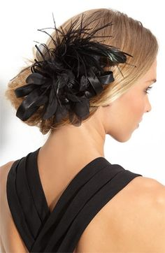 Ostrich feathers with ribbons placed dramatically lends an air of mystery.