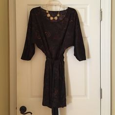 Black Dress from The Limited This is a black dress with gold and plum accents. It is from The Limited and in great shape. It has a tie that comes around the front. The Limited Dresses