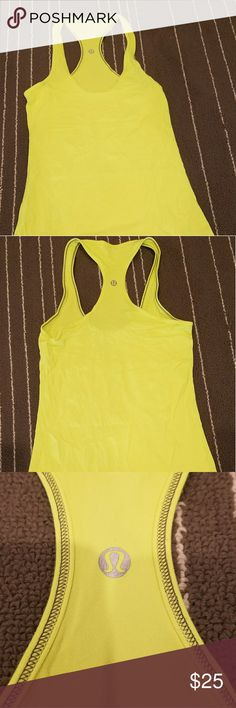 Lululemon Tank Top Lululemon Tank Top  Size 6 ( ? No size printed on it but compared to a size 6 ) NO inserted bra  Bright yellow color  No rips, stains or tears  Great condition  Make an offer! Check out the rest of my closet!!!! lululemon athletica Tops Tank Tops
