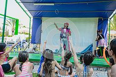 Omer (Beer-Sheva), ISRAEL -Children In Swimsuits On The Grass And A Clown On The Summer Stage Near The Pool- July 25, 2015 - Download From Over 36 Million High Quality Stock Photos, Images, Vectors. Sign up for FREE today. Image: 57355318