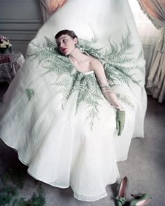 Bettina Graziani pictured in an out take for Vogue magazine wearing just the skirt of a Jaques Fath ensemble by Norman Parkinson 195