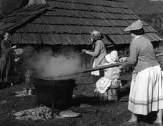 Stirring apples to make homemade apple butter.