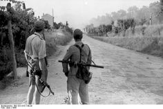 Italian soldiers guarding a road, 1944; note German MP 40 and Soviet PPSh-41 submachine guns | World War II Database