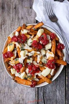 One of the most delicious ways to use Thanksgiving leftovers to make this easy turkey poutine recipe. Instead of a turkey sandwich serve the leftover turkey, giblet gravy and cranberry sauce over crispy sweet potato fries and melty cheese curds to make turkey poutine. This recipe is so delicious, you might make Turkey poutine year round! Turkey poutine with gravy, turkey, sweet potato fries, cheese curds with a white napkin. I start my Thanksgiving prep making a batch of Thanksgiving turkey…