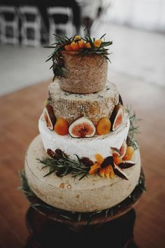 Love: Nicole & Ernest at Heritage Prairie Farm We LOVE this fig topped wedding cake with dried apricots and greens. A decadent feast for the eyes!We LOVE this fig topped wedding cake with dried apricots and greens. A decadent feast for the eyes! Wedding Cake Guide, Wedding Cake Rustic, Fall Wedding Cakes, Wedding Cake Designs, Fruit Wedding, Wedding Cakes Made Of Cheese, Wedding Favors, Wedding Events, Wedding Ideas