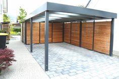 Carport ,Einzelcarport,  betongrau, mit Wandfeldern, Schiebetür, schickem Sektionaltor und Torantrieb