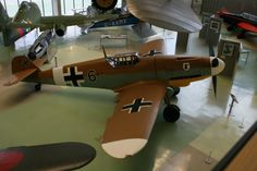 """Another 109 in the RAF Hendon Museum, London. Messerschmidt  Bf-109G """"Gustav"""" which was the later, most common version.  This particular aircraft was captured by the British in North Africa. Messerschmitt Me-262 hanging to left."""