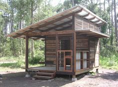 Small cabin with a slanted roof.