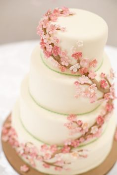 A graceful cake idea.  The clustered blossoms is more realistic of how Cherry blossom's look on the tree.  :)