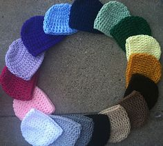 Simple, basic beanie available in every single size. Using double crochet stitches, and a large hook (J), these beanies work up very fast. Been used time and again by myself and many others with little to no problems with sizing, or confusion.