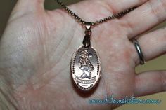 How to make a souvenir necklace out of one of your Disney World pressed pennies!