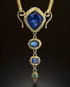 Tantalizing Tanzanite! 14.10 CT Ocean Blue Tanzanite with Rainbow Moonstone, Tanzanite, and Paraiba Tourmaline Pendant. 18K and 22K Gold. Visit my Studio Workshop and Gallery now through March 24th, 2017 at the Celebration of Fine Art. If you live in or visit Arizona stop by to see me 10 AM to 6 PM 18400 N Scottsdale Rd Scottsdale Arizona. 100 Artists Studios in one location, Fantastic Art, Sculpture, Jewelry, Glass, and Ceramic. Image copyright Jeff Scovil.