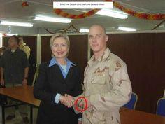 "NOT a fan of Hillary, this US soldier flashed the ""coercion"" sign with his left hand when he met Senator Clinton while serving in Iraq in 2003."