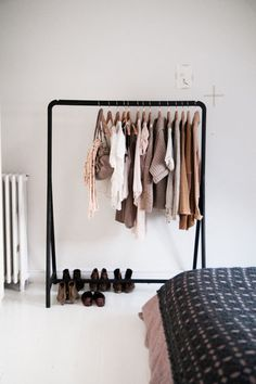 """Choosing to display clothing in a tightly edited color palette helps the rack look chic & intentional rather than cluttered — other clothes hide behind closed doors."""