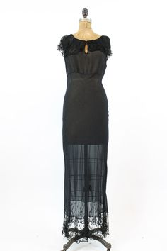 Stunning 1920s I. Magnin silk dress! Done in soft lightweight black silk. Delicate black lace adorns the neck and hemline. Pull over style. Keyhole neckline with hook and eye closure. Can be worn as a dress or for lingerie!  ♥♥♥ Brand: I. Magnin Size on tag: None Fits like: XS Color: Black Material: Silk Condition: Excellent Vintage: The lace is so incredible soft and delicate, this has resulted in some breaks throughout. The silk is in incredible almost pristine condition with only two…