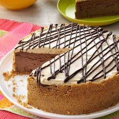 """Blissful Peanut Butter-Chocolate Cheesecake -  When I think of this specialty cheesecake, three words come to mind: """"decadent,"""" """"fun"""" and """"delicious. One bite and I think you'll agree this dessert is pure bliss. —Julie Ruble, Charlotte, North Carolina"""