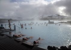 Relaxing in the Blue Lagoon geothermal spa in Grindavik, Iceland. Despite having an Economy ranking of Iceland is in Safety and Security. Best Honeymoon Locations, Blue Lagoon Spa, Places Around The World, Around The Worlds, Unusual Hotels, Vacation Destinations, Dream Vacations, So Little Time, Iceland