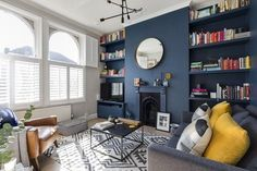 Dramatic and contemporary dark blue interior design - the transformation of my Victorian living room. Stiffkey Blue walls by Farrow & Ball, contrasted with Ammonite grey walls. Dark walls in a living room don't need to mean a dark space, here the mix of t Living Room Grey, Living Room Modern, Living Room Bedroom, Living Room Designs, Home And Living, Living Room Decor, Blue And Mustard Living Room, Living Rooms, London Living Room