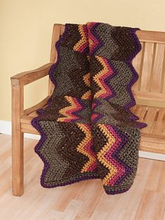 This chevron-style afghan brings a contemporary look to any room. (Lion Brand Yarn)