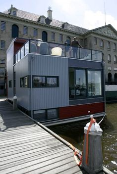 Floating Container home--- or space. Wouldn't it be great to have a  ( wonderful ambiance) floating container restaurant, popping up where desired?