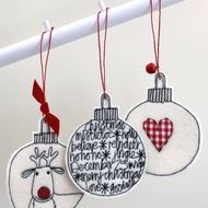 A set of three wool felt baubles; Christmassy words a gingham heart and Mr Reindeer make each one unique. Wool felt baubles are created using cream wool felt gingham cloth free hand machine embroidery with a bell and ribbon to finish them off. Knitted Christmas Decorations, Felt Decorations, Felt Christmas Ornaments, Christmas Stocking, Christmas Baubles To Make, Christmas Makes, Christmas Art, Christmas Projects, Handmade Christmas