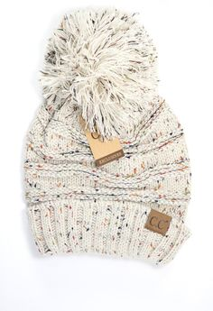 Love the flecked beanies?  You will love this NEW oversize design with a pom on the end.  It looks warm, cozy and of course chic!
