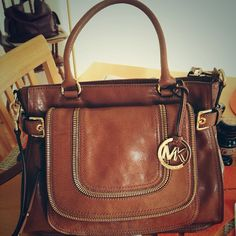 Brown leather MK bag<3. I like this because the brown leather tones down the gold.