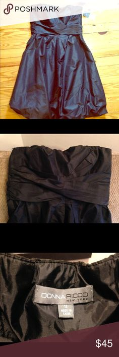 A black dress that will captivate an entire room. This little number is flattering to any figure.  It's a size 12, never worn, and new with tags. Donna Ricco Dresses Strapless